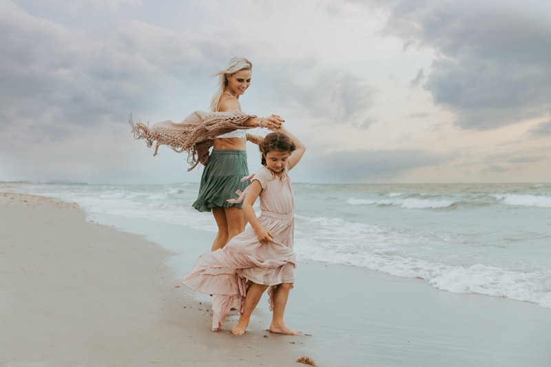 Fort Lauderdale Family Photographer, mother and child walking hand in hand on the beach