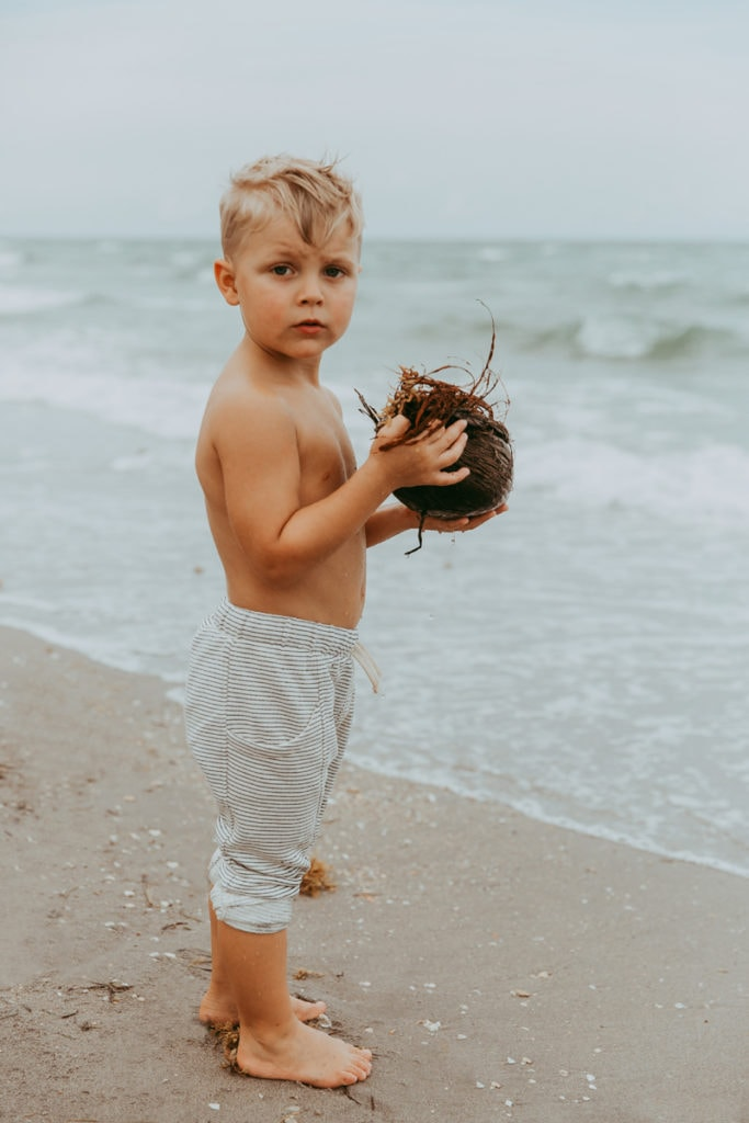 Fort Lauderdale Family Photographer, little boy holding a coconut on the beach