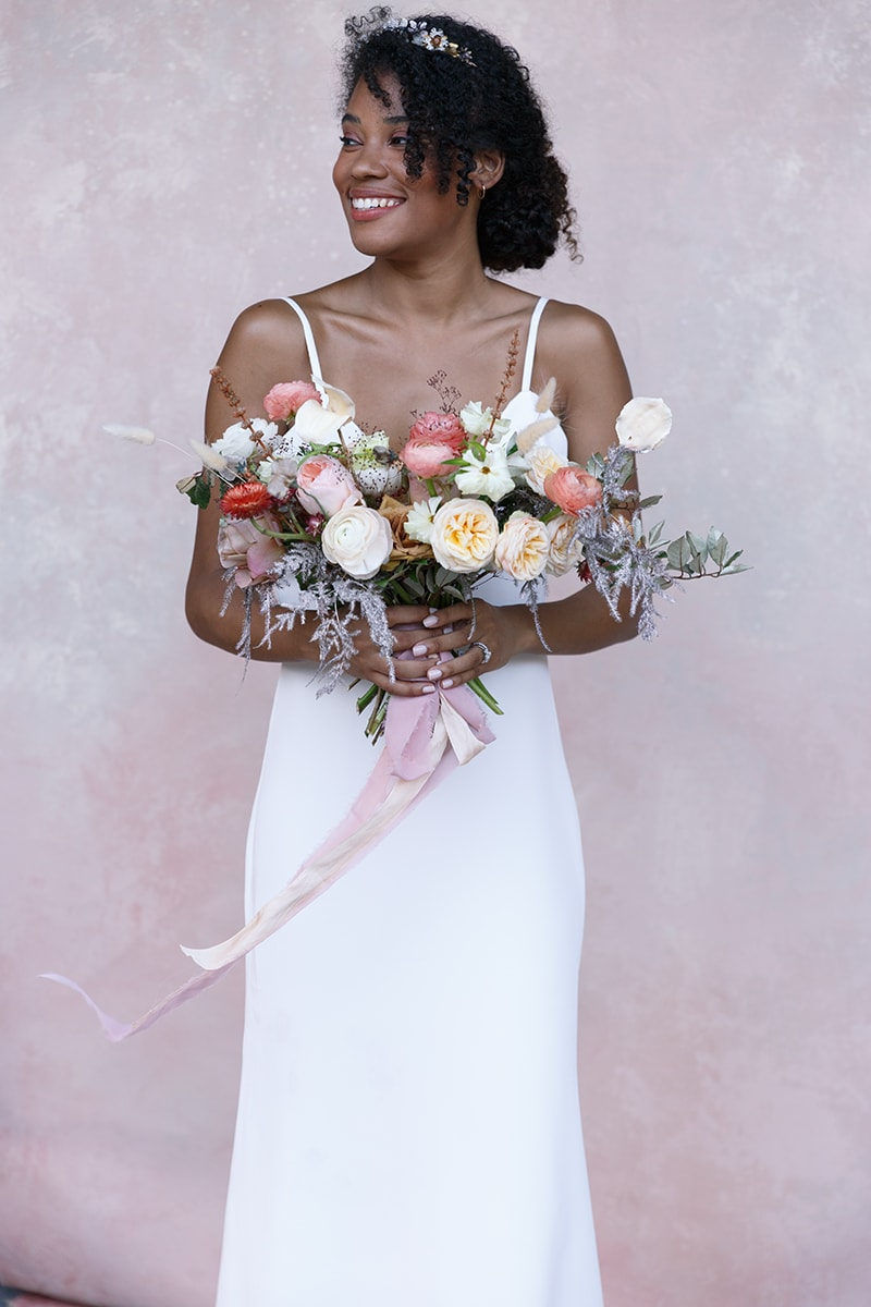 wedding photographer, a bride holds a bouquet of flowers