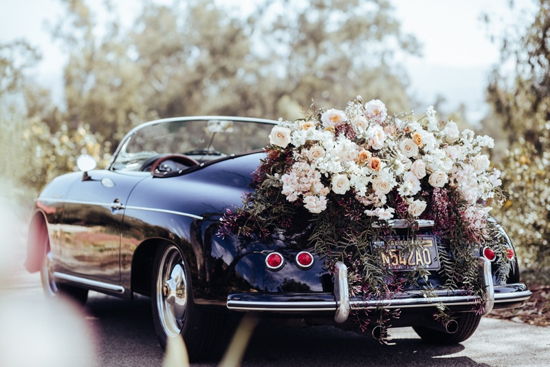 Fort Lauderdale Wedding Photographer, bride and groom getaway care with flowers on the back