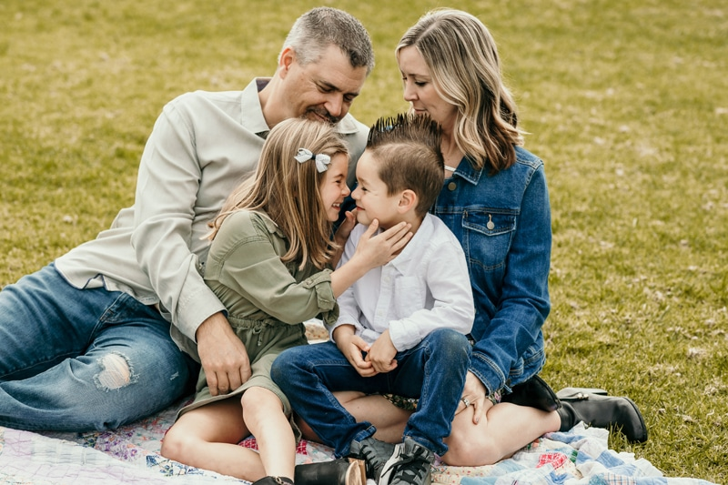 Fort Lauderdale Family Photographer, family of 4 sitting together in the grass