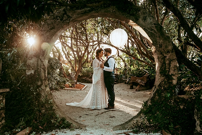 wedding photographer, bride and groom dance outdoors in a wooded area
